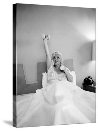Entertainer Mae West Lifitng Barbells in Bed-Loomis Dean-Stretched Canvas Print