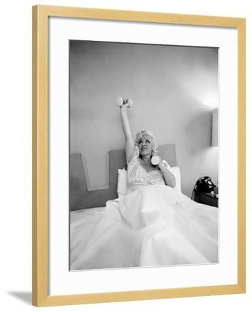 Entertainer Mae West Lifitng Barbells in Bed-Loomis Dean-Framed Photographic Print