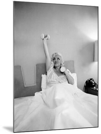 Entertainer Mae West Lifitng Barbells in Bed-Loomis Dean-Mounted Photographic Print