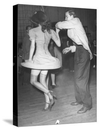 An Aircraft Worker Dancing with His Date at the Lockheed Swing Shift Dance-Peter Stackpole-Stretched Canvas Print