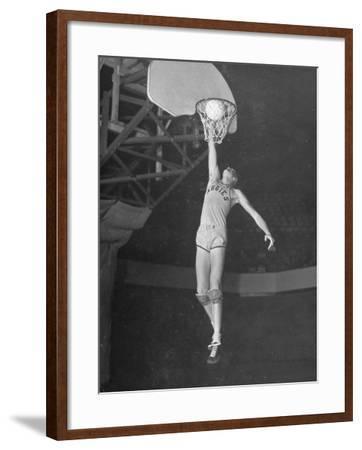 Texas A&M Basketball Player Bob Kurland Reaching to Make a Basket-Myron Davis-Framed Photographic Print
