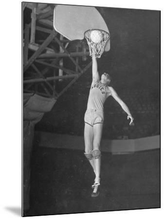 Texas A&M Basketball Player Bob Kurland Reaching to Make a Basket-Myron Davis-Mounted Photographic Print