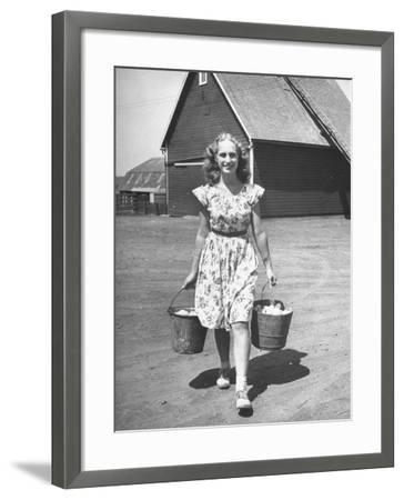 Francis Larson Collecting Eggs on Her Farm-Bob Landry-Framed Photographic Print