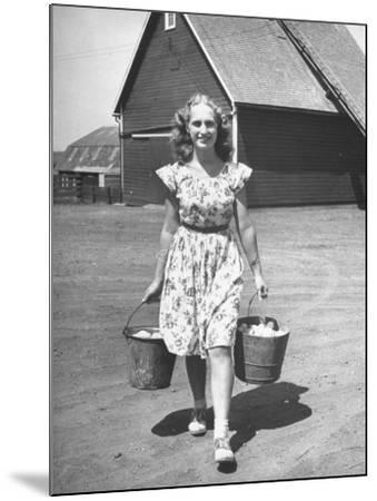 Francis Larson Collecting Eggs on Her Farm-Bob Landry-Mounted Photographic Print