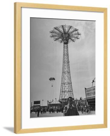People Enjoying a Ride at Coney Island Amusement Park-Ed Clark-Framed Photographic Print