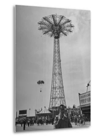 People Enjoying a Ride at Coney Island Amusement Park-Ed Clark-Metal Print