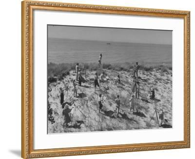 Artists Sketching and Painting Nude Model on Beach--Framed Photographic Print