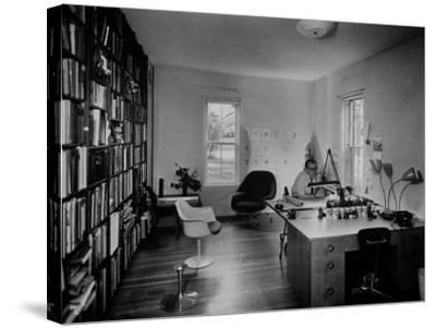 Architect Eero Saarinen Sitting in His Studio at Home--Stretched Canvas Print