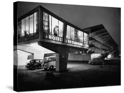 New Motel, Restaurant and Glass and Steel Garage-Ralph Crane-Stretched Canvas Print