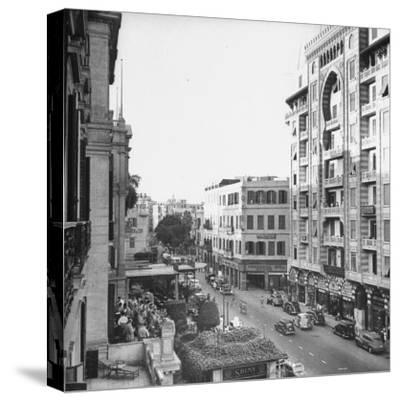 City Street from Room at Shepherd's Hotel-Bob Landry-Stretched Canvas Print