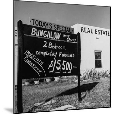 Close-Up of Real Estate Sign-Ed Clark-Mounted Photographic Print