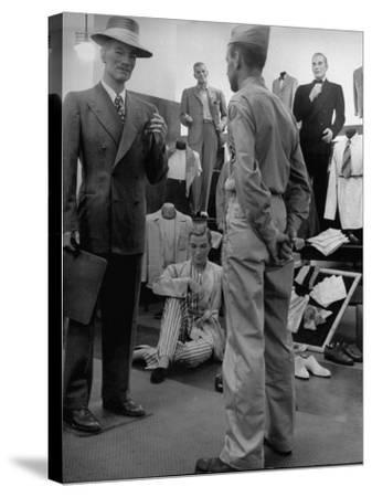 Discharged Gi Looking at New Suit Fashions-Nina Leen-Stretched Canvas Print
