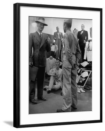 Discharged Gi Looking at New Suit Fashions-Nina Leen-Framed Photographic Print