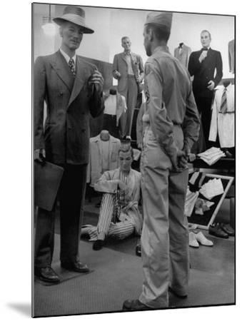 Discharged Gi Looking at New Suit Fashions-Nina Leen-Mounted Photographic Print