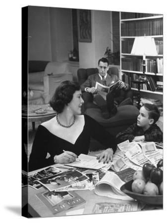 American Housewife Margaret Carson Sitting at Home with Her Husband and Son-Nina Leen-Stretched Canvas Print