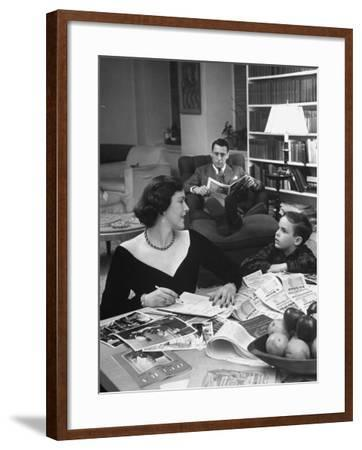 American Housewife Margaret Carson Sitting at Home with Her Husband and Son-Nina Leen-Framed Photographic Print