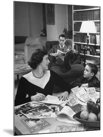 American Housewife Margaret Carson Sitting at Home with Her Husband and Son-Nina Leen-Mounted Photographic Print