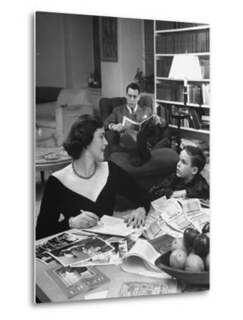 American Housewife Margaret Carson Sitting at Home with Her Husband and Son-Nina Leen-Metal Print