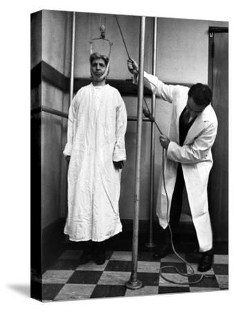 Arthritis Patient Being Treated with Stretching Device at Clinic-Alfred Eisenstaedt-Stretched Canvas Print