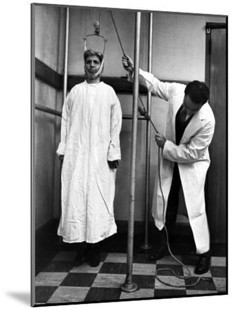 Arthritis Patient Being Treated with Stretching Device at Clinic-Alfred Eisenstaedt-Mounted Photographic Print