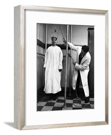 Arthritis Patient Being Treated with Stretching Device at Clinic-Alfred Eisenstaedt-Framed Photographic Print