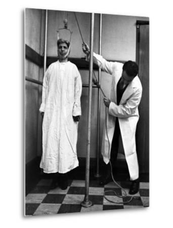 Arthritis Patient Being Treated with Stretching Device at Clinic-Alfred Eisenstaedt-Metal Print