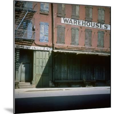 Shuttered Warehouse on the Lower East Side Lit by Late Day Sunlight--Mounted Photographic Print