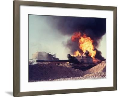 Iraqi Tank Burning While US Army Convoy Drives Past into Iraq During Gulf War-Ken Jarecke-Framed Photographic Print