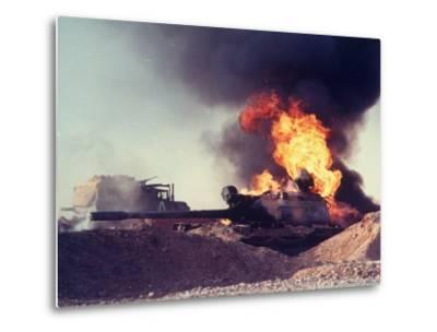 Iraqi Tank Burning While US Army Convoy Drives Past into Iraq During Gulf War-Ken Jarecke-Metal Print