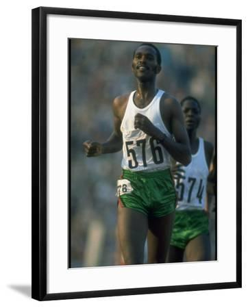 Track Athlete Kip Keino in Action at the Summer Olympics-John Dominis-Framed Premium Photographic Print