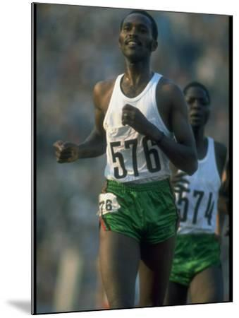 Track Athlete Kip Keino in Action at the Summer Olympics-John Dominis-Mounted Premium Photographic Print