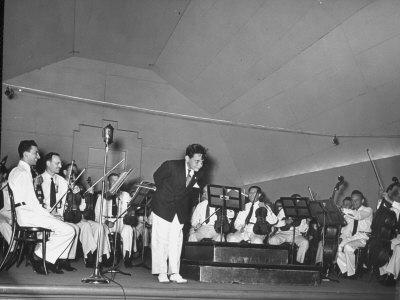 Young Conductor Lorin Maazel Taking a Bow at a Concert by the Robin Hood Dell Orchestra-Nina Leen-Framed Premium Photographic Print
