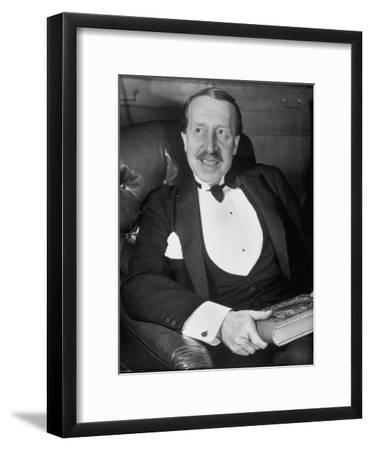 Hungarian Prince George Festetics Clad in Tuxedo While Sitting in Chair at Festetics Castle-Margaret Bourke-White-Framed Photographic Print