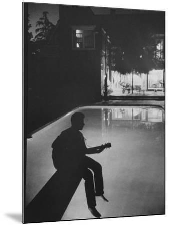 Singer Ricky Nelson Playing Guitar on Poolside-Ralph Crane-Mounted Premium Photographic Print