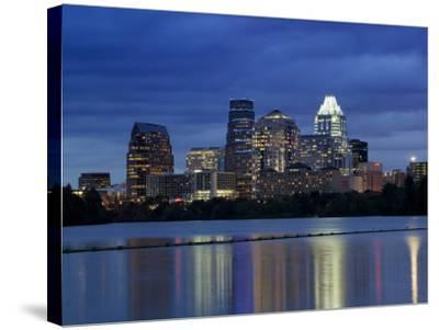 Buildings at the Waterfront Lit Up at Dusk, Town Lake, Austin, Texas, USA--Stretched Canvas Print