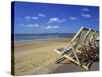 Deckchairs on the Promenade Overlooking Beach, West Cliff, Bournemouth, Dorset, England, UK-Pearl Bucknall-Stretched Canvas Print