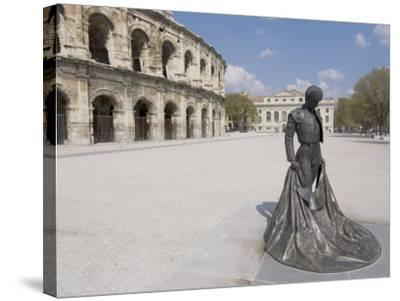 Roman Arena with Bullfighter Statue, Nimes, Languedoc, France, Europe-Ethel Davies-Stretched Canvas Print