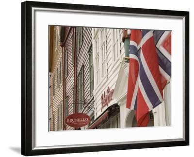 Wooden Merchants Premises and Norwegian Flag, Bryggen Old Harbour Side, Bergen, Norway, Scandinavia-James Emmerson-Framed Photographic Print