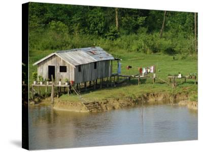 Wooden House with Plants and a Garden in the Breves Narrows in the Amazon Area of Brazil-Ken Gillham-Stretched Canvas Print