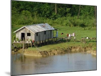 Wooden House with Plants and a Garden in the Breves Narrows in the Amazon Area of Brazil-Ken Gillham-Mounted Photographic Print