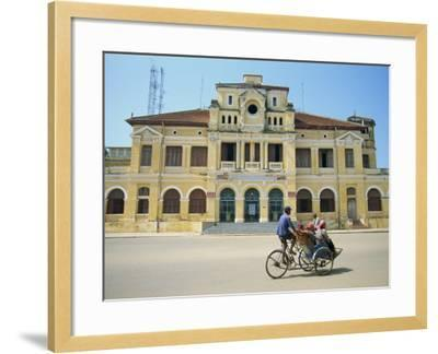 Cyclo Passing the Old Post Office in Phnom Penh in Cambodia, Indochina, Southeast Asia-Tim Hall-Framed Photographic Print