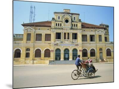 Cyclo Passing the Old Post Office in Phnom Penh in Cambodia, Indochina, Southeast Asia-Tim Hall-Mounted Photographic Print