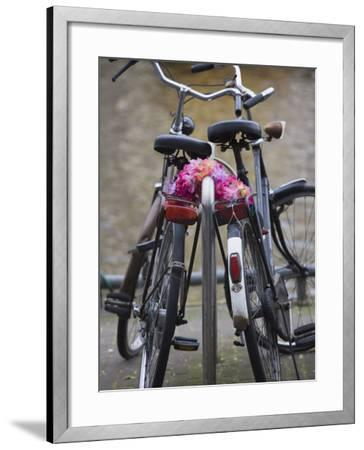 Two Bicycles with a Flower Chain, Amsterdam, Netherlands, Europe-Amanda Hall-Framed Photographic Print