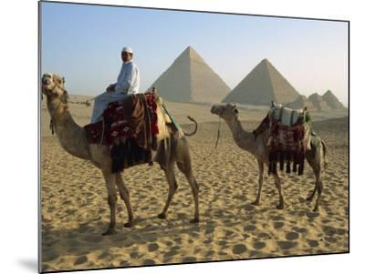 Camels and Rider at the Giza Pyramids, UNESCO World Heritage Site, Giza, Cairo, Egypt-Dominic Harcourt-webster-Mounted Photographic Print