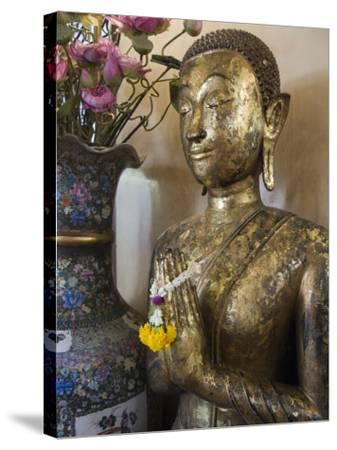 Buddha at Sukhothai Traimit Temple, Bangkok, Thailand, Southeast Asia-Robert Harding-Stretched Canvas Print