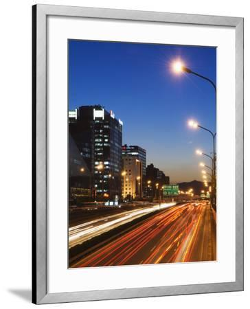 Car Light Trails and Modern Architecture on a City Ring Road, Beijing, China-Kober Christian-Framed Photographic Print