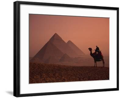 Camel and Rider at Giza Pyramids, UNESCO World Heritage Site, Giza, Cairo, Egypt-Howell Michael-Framed Photographic Print