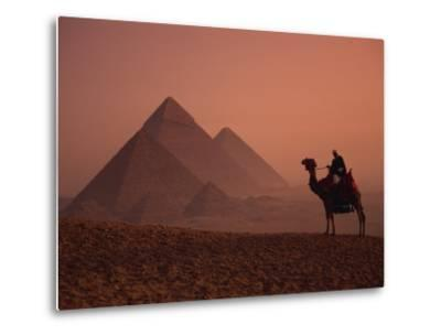 Camel and Rider at Giza Pyramids, UNESCO World Heritage Site, Giza, Cairo, Egypt-Howell Michael-Metal Print