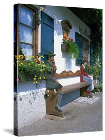 Figures Carved on a Bench on a Decorative House Front at Garmisch Partenkirchen in Bavaria, Germany-Gavin Hellier-Stretched Canvas Print