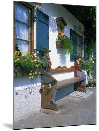 Figures Carved on a Bench on a Decorative House Front at Garmisch Partenkirchen in Bavaria, Germany-Gavin Hellier-Mounted Photographic Print